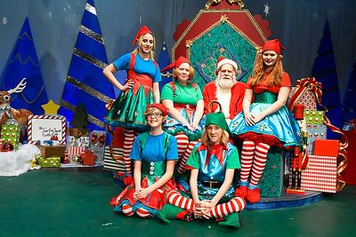 Dan Washburn (Kris Kringle) is surrounded by elves Kenzy Harshman, Sarah Frantz, Roz Mclerran, Gemma Frantz and Lance Frantz Wednesday December 5, 2018 at the Gaslight Theatre. (Billy Hefton / Enid News & Eagle)