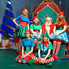 Dan Washburn (Kris Kringle) is surrounded by elves Kenzy Harshman, Sarah Frantz, Roz Mclerran, Gemma Frantz and Lance Frantz Wednesday December 5, 2018 at the Gaslight Theatre. (Billy Hefton / Enid News & Eagle)