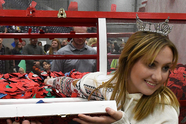 Miss NOC Enid pulls the grand prize winning ticket in the 16th Candy Cane Cash drawing Tuesday, December 10, 2019 at the Chisholm Trail Expo Center. (Billy Hefton / Enid News & Eagle)