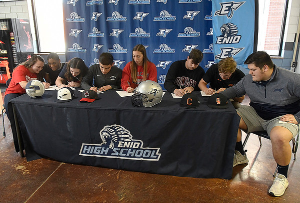 Enid High School seniors, (left to right) Megan Hart, D'Sani Levy, Gabriella Cotarelo, Anthony Carranza, Elizabeth Ostermaier, Colby Jarnagin, Connor Gore and Kaleb Stanley, during a signing celebration at Enid High School Tuesday, December 11, 2019. (Billy Hefton / Enid News & Eagle)