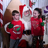 Briley and Dalton Neil visit with Santa at the 16th Candy Cane Cash drawing Tuesday, December 10, 2019 at the Chisholm Trail Expo Center. (Billy Hefton / Enid News & Eagle)
