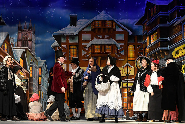 "Cast members rehearse a scene from the Gaslight Theater production of ""Scrooge!"" Wednesday, December 4, 2019 at the Gaslight Theater. (Billy Hefton / Enid News & Eagle)"