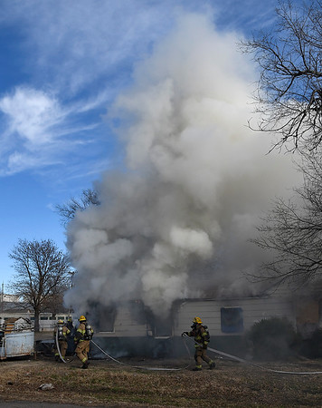 Enid firefighters work a structure fire at 802 East Popular Tuesday, December 3, 2019. (Billy Hefton / Enid News & Eagle)