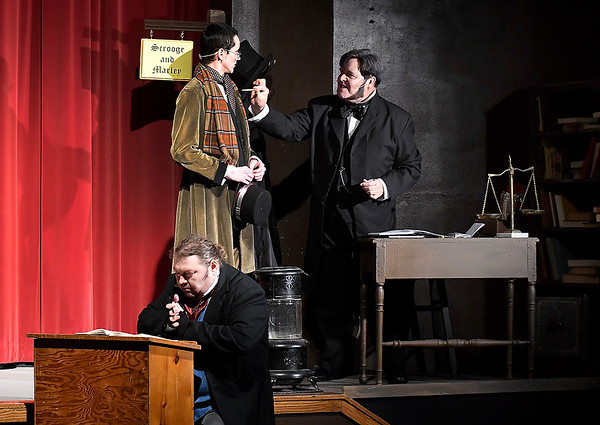 "Mike Weatherford, Blake Rechnagel and Matthew Houston rehearse a scene from the Gaslight Theater production of ""Scrooge!"" Wednesday, December 4, 2019 at the Gaslight Theater. (Billy Hefton / Enid News & Eagle)"
