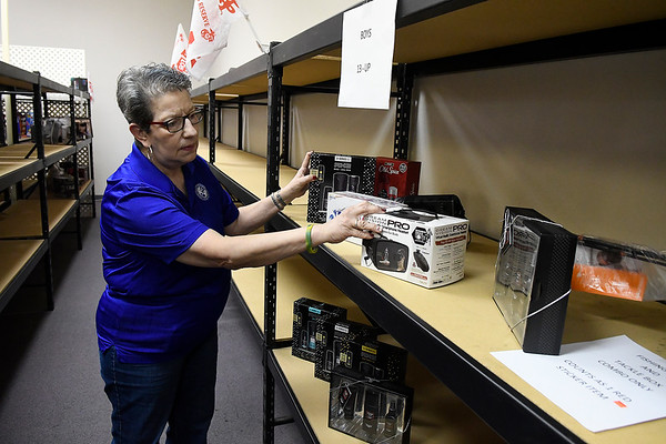Toys for Tots coordinator, organizes the few items on the shelves for 13 and up boys Tuesday, December 3, 2019. (Billy Hefton / Enid News & Eagle)