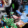 Becca Robinson organizes gifts at Christmas Outreach put on by Forgotten Ministries, Your Family Church, Enid Mennonite Brethren Church and local donors Tuesday, December 17, 2019 at Don Haskins Park. (Billy Hefton / Enid News & Eagle)