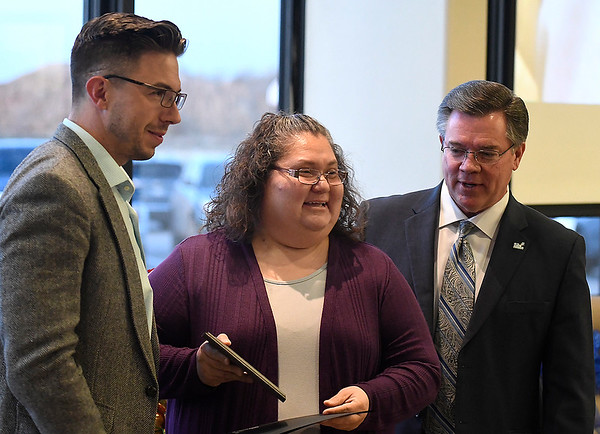 Elvira Lopez stands with Taylor Venus (left), President Enid Public School Foundation and Dr Darrell Floyd (right), Superintendent Enid Public Schools, after being named the Enid Public Schools Support Professional of the Year during an Education Celebration at Prairie View Elementary Wednesday, December 11, 2019. (Billy Hefton / Enid News & Eagle)
