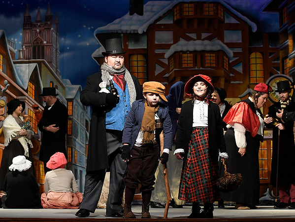 """(left to right) Matthew Houston, James Harvey and Lindy Pitts rehearse a scene from the Gaslight Theater production of """"Scrooge!"""" Wednesday, December 4, 2019 at the Gaslight Theater. (Billy Hefton / Enid News & Eagle)"""