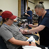 Phlebotomist, Shari Moore, prepares NOC Enid student, Ashlee Moore, to donate blood during  a blood drive at the NOC Enid Gantz Center Monday, December 2, 2019. (Billy Hefton / Enid News & Eagle)