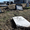 Damaged headstones at the Enid Cemetery where a vehicle ran through the fence following a police pursuit November 26. (Billy Hefton / Enid News & Eagle)
