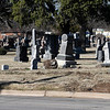 Section of fence and damaged headstones at the Enid Cemetery where a vehicle ran through the fence following a police pursuit November 26. (Billy Hefton / Enid News & Eagle)