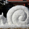 A snow sculpture of a snail in the yard of a house on west Ramona Drive Monday, December 14, 2020. (Billy Hefton / Enid News & Eagle)