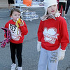 Cassidy Patterson munches on a banana as she relaxes with her sister, Cameryn, after they raced during the Junior Welfare League Warm Your Heart 5K and family fun run Saturday, Feb. 2, 2013. (Staff Photo by BONNIE VCULEK)