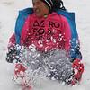 Judith Huerta enjoys the winter weather sledding Thursday, Feb. 21, 2013. (Staff Photo by BONNIE VCULEK)