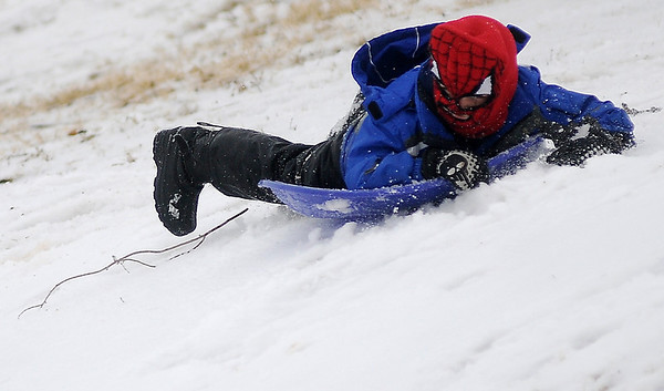 A young boy sports a Spiderman stocking cap as he navigates the South Van Buren slope on his sled Thursday, Feb. 21, 2013. Enid area schools were closed due to the upper level winter storm that dropped approximately 7 inches of rain, freezing rain, snow and sleet across Northwest Oklahoma. (Staff Photo by BONNIE VCULEK)