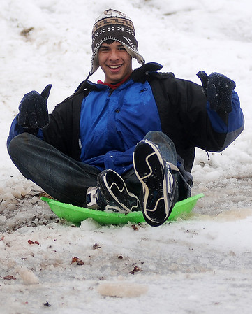 Justin Miles enjoys a break from Enid High School classes as he sleds the slope of the South Van Buren overpass Thursday, Feb. 21, 2013.  Schools across most of Oklahoma were closed due to an upper level storm system that produced rain, freezing rain, sleet, snow and thunder sleet during the night. (Staff Photo by BONNIE VCULEK)