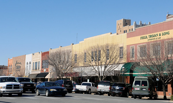 Businesses in downtown Enid welcome shoppers each day. (Staff Photo by BONNIE VCULEK)
