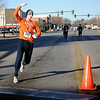 Seth Hyde, overall men's winner of the Junior Welfare League Warm Your Heart 5K run rounds the halfway cone in downtown Enid Saturday, Feb. 2, 2013. (Staff Photo by BONNIE VCULEK)