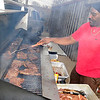 Jimmy Webster cooks steaks for the annual Super Bowl Brothers fundraiser. (Staff Photo by BILLY HEFTON)