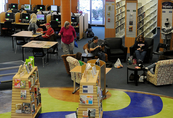 Patrons relax as they crochet, read a newspaper, work on computers or check out books during their visit to the Public Library of Enid and Garfield County Friday, Feb. 22, 2013. (Staff Photo by BONNIE VCULEK)
