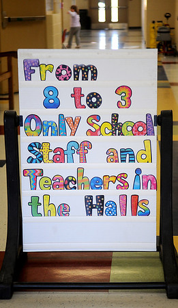 """A colorful sign, """"From 8 to 3 Only School Staff and Teachers in the Halls,"""" greets visitors at Monroe Elementary School's front entrance. (Staff Photo by BONNIE VCULEK)"""