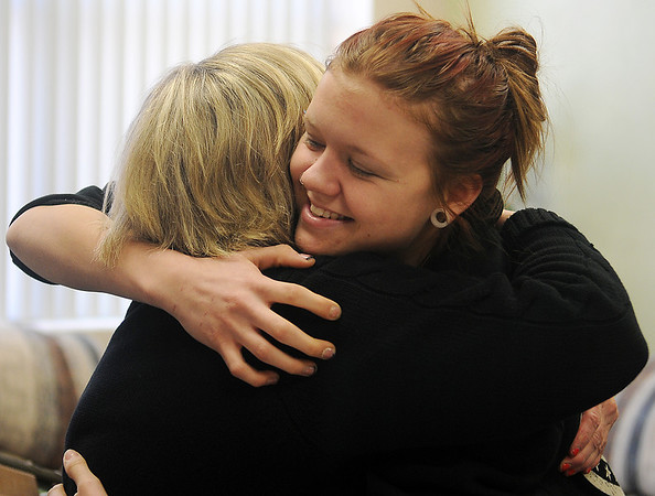 Lincoln Academy counselor, Susie Skaggs, receives a hug from Ciara Zumalt Tuesday, Feb. 19, 2013. Lincoln Academy has provided successful alternative education opportunities for Enid Public School students. (Staff Photo by BONNIE VCULEK)
