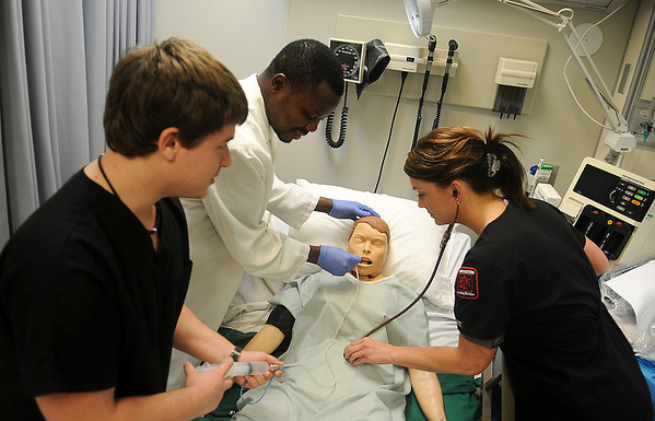 NWOSU students (from left) Ryan Cooper, Titus Bakare and Frannie Landrigan perfect their nursing skills at the Emma Lee Tucker Ketterman Clinical Simulation Lab at the Enid campus Thursday, Feb. 7, 2013. (Staff Photo by BONNIE VCULEK)