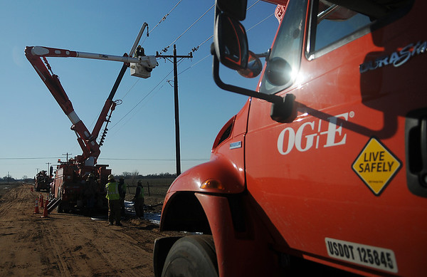 OG&E crews repair or replace more than 50 high line poles, cross arms and service lines one mile south of Ames Thursday, Feb. 28, 2013. Approximately 4500 Enid area homes have no electricity. (Staff Photo by BONNIE VCULEK)