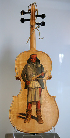 """""""Geronimo's Fiddle,"""" designed by renowned artist H.T. Holden from Kremlin, pays tribute to the most famous of all Apaches. A Native American fiddle was commonly made of a hollowed out agave stalk that was carved, a single string added and used for """"wood singing. (Staff Photo by BONNIE VCULEK)"""