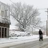 A pedestrian uses a walker on N. Independence as he moves through slushy snow during a winter storm Wednesday, Feb. 20, 2013. (Staff Photo by BONNIE VCULEK)