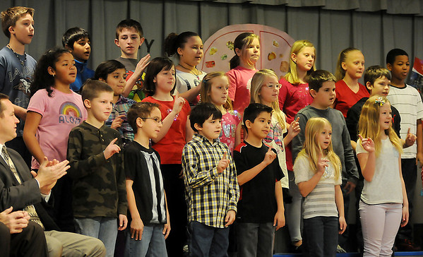 Hayes Elementary School's fourth grade students sing during the school's Healthier US Silver School assembly Thursday, Feb. 14, 2013. The Hayes Hawks were the only Oklahoma school to receive the prestigious award from the USDA. (Staff Photo by BONNIE VCULEK)