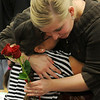 Ms. Tara Harmon (right), a first-year teacher, gives Elizabeth Martinez a hug after Martinez presents her with two long-stem red roses during the kindergarten's special Valentine's Day games at Hayes Elementary School Thursday, Feb. 14, 2013. (Staff Photo by BONNIE VCULEK)