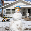 A bicycle helmet tops a child's snowman creation at 1618 W. Broadway Friday, Feb. 22, 2013. Temperatures remained in the upper 20s with the wind chill in the single digits after a winter storm produced 7 inches of precipitation in the Enid area. (Staff Photo by BONNIE VCULEK)