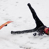 Claire Andrews's snow board flies through the air as she tumbles down the South Van Buren overpass slope Thursday, Feb. 21, 2013, in Enid, Okla.  Temperatures dropped into the upper 20s as an upper level winter blast produced lightning, heavy rain, snow and thunder sleet, canceling school and college classes across most of Oklahoma. (AP Photo/Enid News and Eagle, Bonnie Vculek)