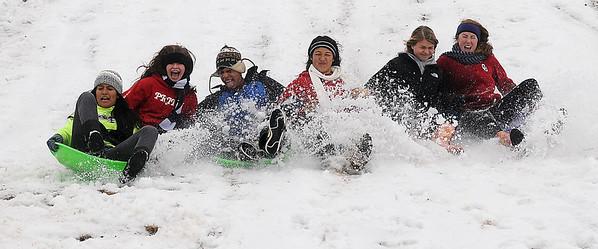 Enid High School soccer players sled the South Van Buren overpass slope Thursday, Feb. 21, 2013. (Staff Photo by BONNIE VCULEK)