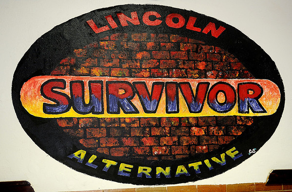 A Lincoln Alternative survivor logo, designed by a former student, graces the south hallway entrance to the school Tuesday, Feb. 19, 2013. Lincoln Academy, who will have 75 graduating seniors in May, offers successful alternative education to Enid Public School students. (Staff Photo by BONNIE VCULEK)