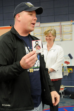 Hayes Elementary School principal Jane Johnson (back, right) laughs as PTA volunteer, Chad Quin, plays a bingo game with kindergarten students Thursday, Feb. 14, 2013. Quin, who volunteers regularly at the school, received his own Valentine's Day cards from the students. (Staff Photo by BONNIE VCULEK)