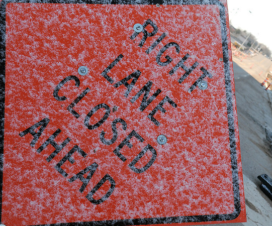 Icy and snow coats a highway sign on S. Independence, making it difficult to read Saturday, Feb. 16, 2013. (Staff Photo by BONNIE VCULEK)