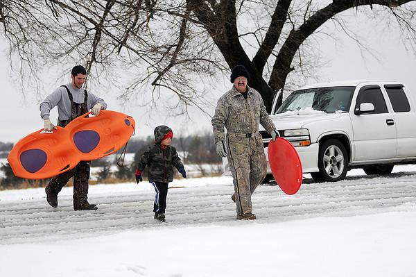 A family prepares for a day of sledding fun Thursday, Feb. 21, 2013. (Staff Photo by BONNIE VCULEK)