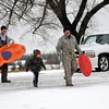 A family prepares for a day of sledding fun Thursday, Feb. 21, 2013. (Staff Photo by BONNIE VCULEK)
