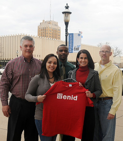 Inspire Greater Enid board members (from left) Kelly Goodwin, Nicole Winfield, Derrick Silas, Deborah Cromwell and Curtis Tucker pause near the entrance of Enid Convention and Visitors Bureau Thursday, Feb. 7, 2013. (Staff Photo by BONNIE VCULEK)