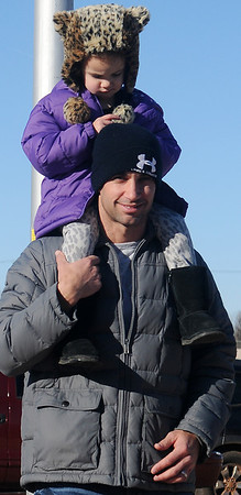 Anna Whitman has the best seat in the AMBUCS' Trot 4 Trykes 5K run/walk as she waits atop her dad's shoulders for her mom to finish the race Saturday, Feb. 16, 2013. (Staff Photo by BONNIE VCULEK)
