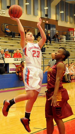 Chisholm's Kammi Gruber hits a short jumper against Oklahoma Centennial's Taylor Roberts during the Lady Longhorns 58-47 win over the Lady Bison in the OSSAA Class 3A Area 1, District 1 Championship at Chisholm Saturday, Feb. 16, 2013. (Staff Photo by BONNIE VCULEK)