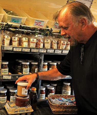 Charley Wooden selects several items as he shops during Farmers Market at Hope Outreach Tuesday, Feb. 5, 2013. Wooden was shopping at the local market for the first time. (Staff Photo by BONNIE VCULEK)