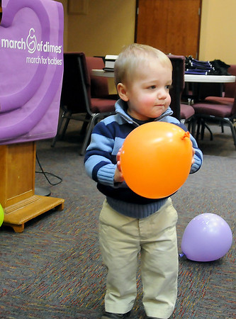 Hudson DePriest plays with balloons during the March of Dimes 75th Birthday Celebration at Emmanuel Baptist Church Thursday, Feb. 28, 2013. DePriest, the 2013 March of Dimes March for Babies Ambassador, was born prematurely after only 28 weeks in the womb and weighed just 2.7 pounds. (Staff Photo by BONNIE VCULEK)