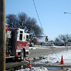 Enid firefighters wait near a downed electrical line at Loaves & Fishes while an OG&E crew responds to the scene Wednesday, Feb. 27, 2013. (Staff Photo by BONNIE VCULEK)