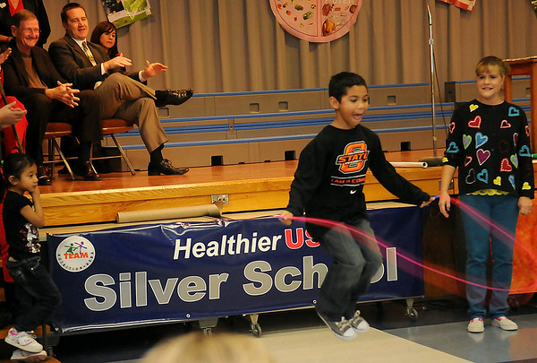 Physical education Instructor, Lisa Bloom (right), watches Davin Jones  as he thrills the crowd with a double-under jump rope skill during the Healthier US Silver School assembly Thursday, Feb. 14, 2013, at Hayes Elementary School. Hayes was the only Oklahoma school recognized for the prestigious award. (Staff Photo by BONNIE VCULEK)