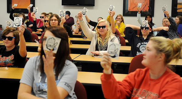 Autry Technology students and staff hold up their pledge stickers after they participated in the AT&T Virtual Reality Texting and Driving Simulations Tuesday, Feb. 19, 2013. (Staff Photo by BONNIE VCULEK)