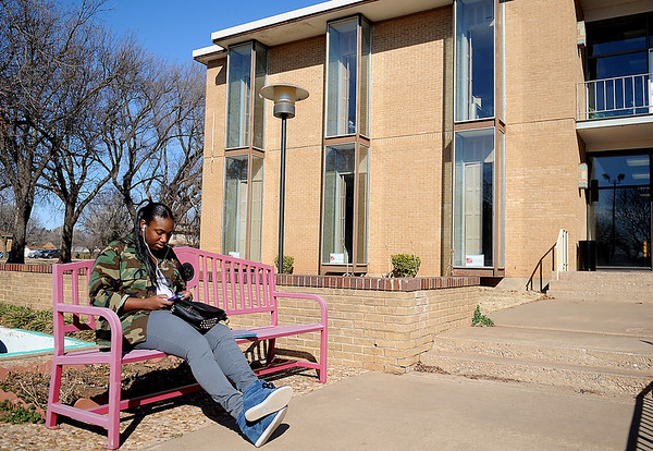 Kenesha Moore relaxes between classes at Northern Oklahoma College-Enid campus Tuesday, Feb. 19, 2013. Moore, who is a freshman student from Brooklyn, New York, attends classes at the local college while her husband is stationed at Vance Air Force Base. (Staff Photo by BONNIE VCULEK)