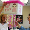 Glenda Abbi (left) holds a birthday pinata designed for her one-year-old granddaughter, Reese, as designer, Carolyn Jones, explains how young children can pull the attached ribbons to release the candy Thursday, Feb. 7, 2013. (Staff Photo by BONNIE VCULEK)